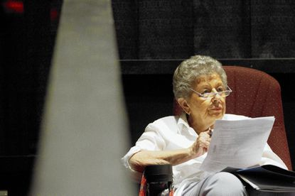 Sylvia Maslan, of Pikesville, listens to a Food for thought lecture given by Bais Yaakov history department chair Chana Kagan at the Pikes Theatre on July 1.