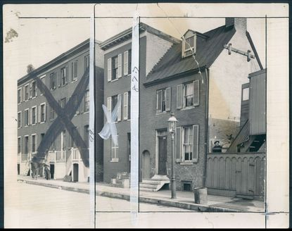 Pictured on Feb. 18, 1938, the site of Edgar Allan Poe's house at 203 Amity St., on the far right. The homes on the left were demolished to make way for low-income housing.