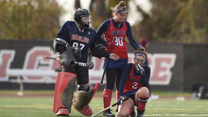 Francis Scott Key goalie Kourtney Black and Suzanne Edwards try to console teammate Hannah Wolf following their 2-0 loss to Patuxent in the Class 1A state final at Washington College on Saturday, Nov. 11.