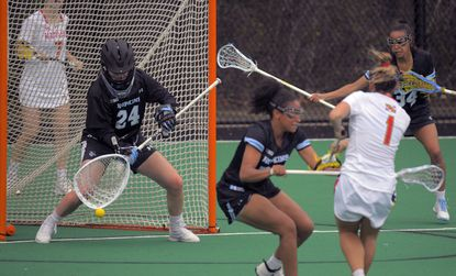 Maryland Terrapins attacker Brindi Griffin (1) shoots around Johns Hopkins Blue Jays midfielder Madison McPherson to score on goalkeeper Kathleen Garvey (24) during the first half of the game on Wed., April 14, 2021.