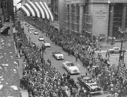 Fans come out for the Opening Day parade in downtown Baltimore for the 1954 season. This was the first year for the Orioles in Baltimore, after spending 52 years in St. Louis. In their first home opener at Memorial Stadium, the Orioles treated the sellout crowd to a 3-1 victory over the Chicago White Sox. (Baltimore Sun file photo).