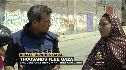 Nick Shifrin covering the Israeli incursion of Gaza for Al Jazeera America