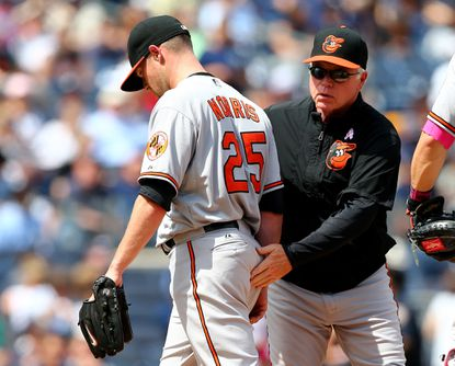 Orioles Manager Buck Showalter removesstarting pitcher Bud Norris (25) in the fourth inning against the New York Yankees on May 10, 2015 at Yankee Stadium. Norris has been scratched from his scheduled start Saturday.