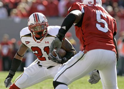 Maryland's Keon Lattimore takes on North Carolina State's Ernest Jones in a 2007 game.