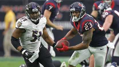 Ravens linebacker Daryl Smith, left, chases Houston Texans running back Arian Foster in Sunday's game.