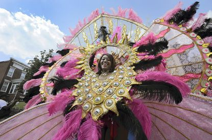 Janelle Cumberbatch of Silver Spring dances in costume at the annual Caribbean Carnival Festival parade on the Alameda.