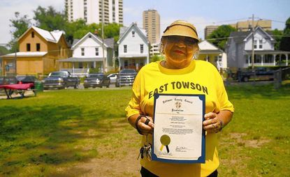 Adelaide Bentley, a long time resident of East Towson, poses for a picture following the dedication of park land in the community, named in her honor, during a neighborhood picnic on Saturday, July 20, 2013.
