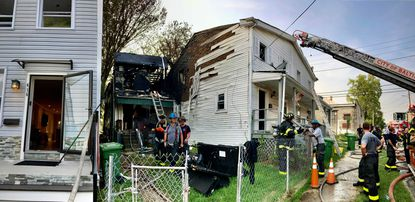 Firemen respond to a house fire in the 400 block of Font Hill Ave. on September 14, 2021.
