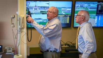Race stewards Ross Pearce, left, and Russell Derderian check the communications system before first race of the day at Pimlico Race Course.