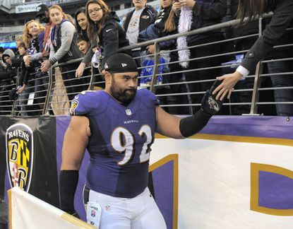 Ravens defensive tackle Haloti Ngata greets fans as he exits the field during a November game against the Chargers.