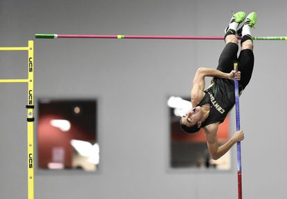 Century's Kyle Bryant hits the pole while competing in the pole vault during the MPSSAA Indoor Track State Championships in Landover Monday, Feb. 22, 2016. Bryant won the pole vault with 13 feet, 6 inches.