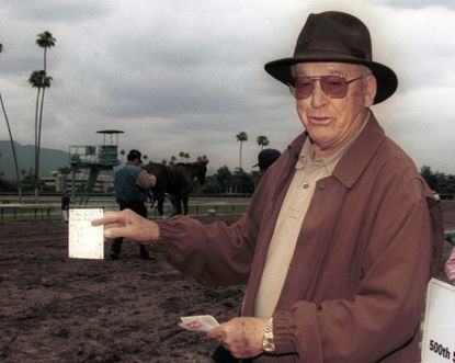 In an April 4, 2004 photo provided by Benoit Photo, Mel Stute is seen at Santa Anita Park in Arcadia, Calif. Mel Stute, trainer of 1986 Preakness winner and Eclipse Award champion 3-year-old male Snow Chief, died Wednesday, Aug. 12, 2020. He was 93.(Benoit Photo via AP)
