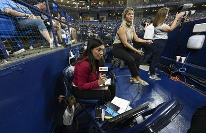 YouTube in-game reporter Alanna Rizzo works in the photo well as part of the first all-female broadcast crew in MLB history during a baseball game between the Tampa Bay Rays and Baltimore Orioles Tuesday, July 20, 2021, in St. Petersburg, Fla. (AP Photo/Steve Nesius)