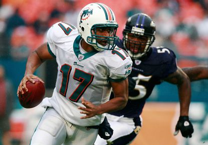 Dolphins quarterback Cleo Lemon rolls out of the pocket as he is chased by linebacker Terrell Suggs at Dolphin Stadium on December 16, 2007 in Miami.