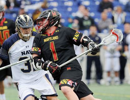 Maryland's Matt Rambo looks for an opening in the Navy defense in the first quarter. The visiting Maryland Terrapins defeated the Navy Midshipmen, 15-12, in NCAA men's lacrosse Saturdayin Navy's home opener at Navy-Marine Corps Memorial Stadium.