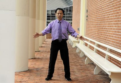 Kevin Chen, an associate professor at the University of Maryland School of Medicine's Center for Integrative Medicine, demonstrates qigong