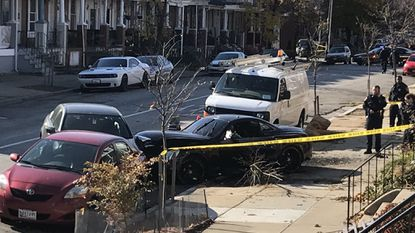 Baltimore police investigate a fatal shooting in the Harwood neighborhood.
