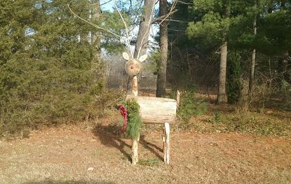 Seeing this log reindeer while driving reminded columnist Lois Szymanski of the days she created log reindeer as well as wreathes to make ends meet at Christmastime.