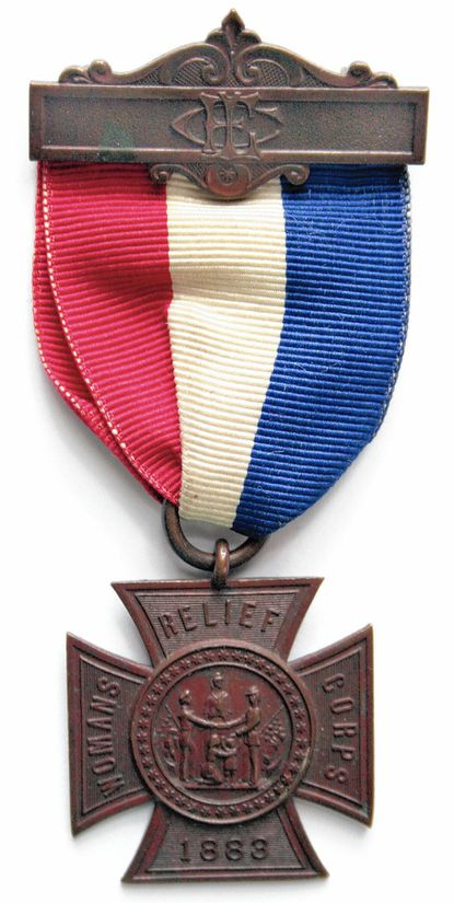 """Members of the Woman's Relief Corps proudly wore badges such as this one belonging to the Historical Society of Carroll County. The Maltese Cross includes the date the Corps was founded, 1883. The W.R.C. motto was """"Fraternity, Charity and Loyalty.&#8221"""