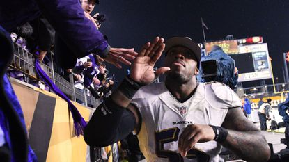 Ravens linebacker Terrell Suggs celebrates with fans after beating the Pittsburgh Steelers. Will he celebrate Saturday in New England?