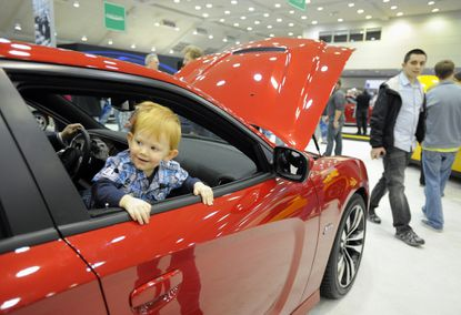 Matthew Gray, 17 months of Edgewood, looks out the window of a 2012 Dodge Charger at the show at the Motor Trend International Auto Show Saturday at the Baltimore Convention Center. The show offered looks (and occasionally even test drives) of hundreds of the hottest things on four tires.