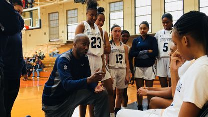 Institute of Notre Dame coach Rob DuBose talks to his team during a timeout late in the fourth quarter against Long Reach during the Public vs Private Challenge at McDonogh on Jan. 12, 2019.