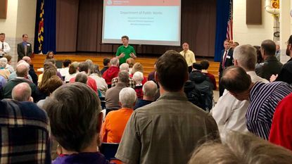 Baltimore County officials speak during a meeting on Thursday, Oct. 18 at Hillcrest Elementary School concerning the fate of Thistle Road and River Road in the Catonsville and Oella area.