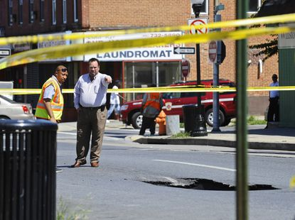 A 10-foot by 2-foot sink hole that is possibly 20-foot deep opened on Monument street east of Patterson Park Avenue closing traffic and businesses in the area for two blocks.