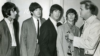 Frank Luber with the Beatles at their hotel in Baltimore in 1965. After 27 years, the veteran broadcaster is leaving mornings on WCBM after Oct. 31.