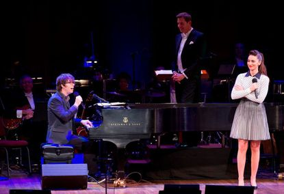 Ben Folds and Sara Bareilles performing at the Kennedy Center, while NSO principal pops conductor Steven Reineke looks on