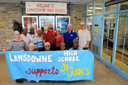 Among the participants at Lansdowne High School who donned bald caps as a show of support for those fighting cancer were, from left: Front row, Julie Cooper, Monyae Kerney, Kaelyn Fisher and Letitia Harvey and back row, Wendy Happel, Torrie Kerney, Anita Hutchins, Michelle Baylor, Daniel Alburger, Natalie Adams, R. Chris Wilde and Luke Simon.