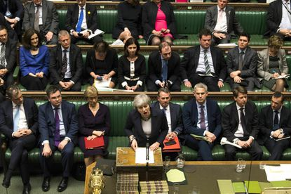 Britain's Prime Minister Theresa May speaks to lawmakers in the House of Commons in London on March 13, 2019.