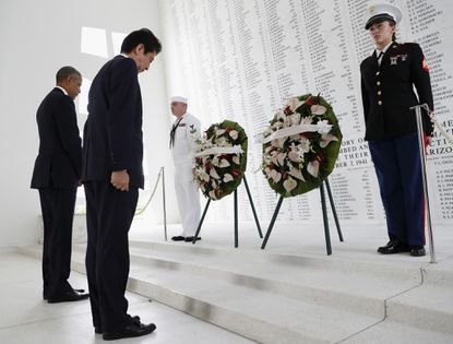 President Barack Obama and Japanese Prime Minister Shinzo Abe participate in a wreath laying ceremony at the USS Arizona Memorial, part of the World War II Valor in the Pacific National Monument, in Joint Base Pearl Harbor-Hickam, Hawaii, adjacent to Honolulu, Hawaii, Tuesday, Dec. 27, 2016, as part of a ceremony to honor those killed in the Japanese attack on the naval harbor.