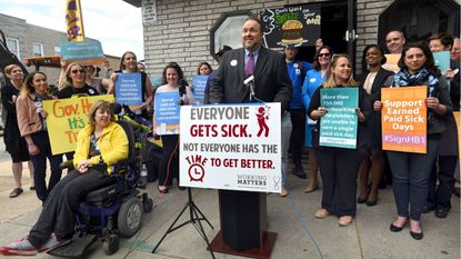 After a House committee turned back an effort to delay the state's new paid sick leave law, Del. Luke Clippinger, the law's sponsor, shown in the center at a rally for the legislation last year, said he was confident Maryland business could figure it out.