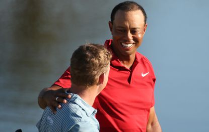 Tiger Woods, top, greets Bud Cauley after both finished putting on the 18th green during the Arnold Palmer Invitational at Bay Hill Club & Lodge in Orlando on Sunday, March 18, 2018.