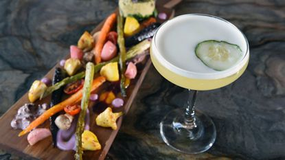 A seasonal veggie board with the cocktail Honey Shine cocktail from Alchemy Elements, which received top votes for best cocktail and best vegetarian options.