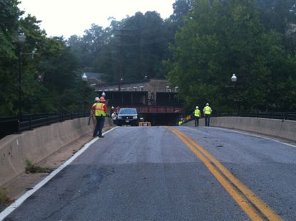 Workers on the scene of a CSX train derailment in Ellicott City which killed two people.