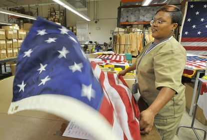 Natasha Fowlkes, an inmate at the Maryland Correctional Institution for Women, is a line supervisor in the Maryland Correctional Enterprises sew plant, where they produce United States, Maryland and War of 1812 flags.