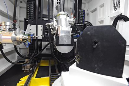 The high-powered CT scanner, pictured with a body armor test subject, right, is expected to expand Chesapeake Testing's business opportunities with the military.