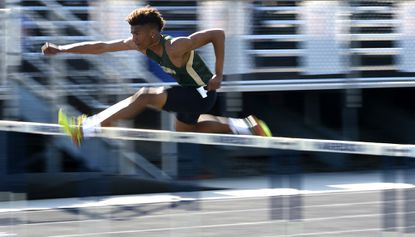 Century's Jalen Stanton stays far ahead of the pack on his way to a victory in the 110-meter hurdles during the Carroll County Athletic League Championship Meet at Manchester Valley High School Tuesday, May 7, 2019.