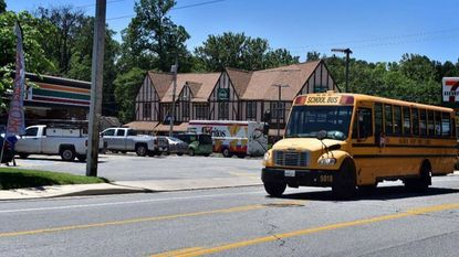 A Baltimore County school bus travels East on Edmondson Ave at Dutton Ave near the former trolly transfer point art Catonsville Junction. Baltimore County Council has authorized the county school board and police department to implement a stop-arm camera system on the county's 800 public schools buses.