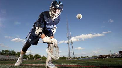 Howard senior Felix Knorr faces off as boys lacrosse Player of the Year