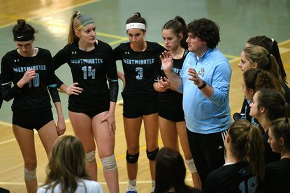 Westminster coach Evan Frock, seen huddling with players during the team's regional playoff win over Mt. Hebron, helped lead the Owls to a straight-set victory over Reservoir in the 3A state quarterfinals on Nov. 8.