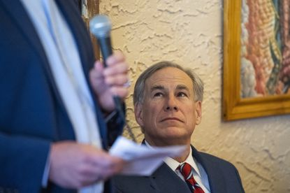 Texas Gov. Greg Abbott is introduced by Dave Marcinkowski in Montelongo's Mexican Restaurant on Tuesday, March 2, 2021, in Lubbock, Texas. Governor Abbott announced that he is rescinding executive orders that limit capacities for businesses and the statewide mask mandate. (Justin Rex/Lubbock Avalanche-Journal via AP)