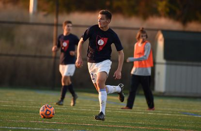 Francis Scott Key's Jakub Mihulka sprints up the field with the ball during a combined practice/scrimmage for Francis Scott Key and Century, on a turf field at Western Regional Park in Woodbine on Tuesday, November 5.