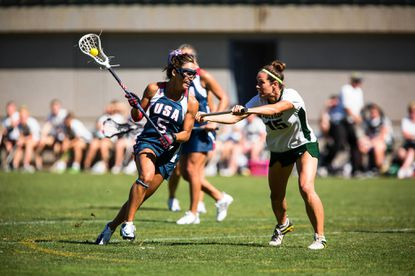 Kelly Berger (left), seen here competing against Australia, will be playing for the United States in the 2013 Federation of International Lacrosse Women's World Cup in July.