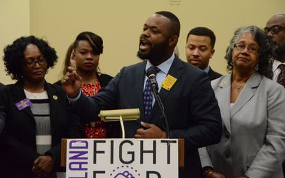 Maryland state Sen. Cory McCray, a Baltimore Democrat, speaks in favor of increasing the state's minimum wage to $15 per hour at a January news conference.