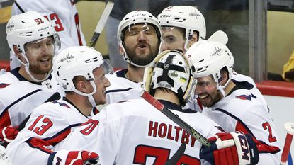 Capitals goaltender Braden Holtby (70) celebrates with Evgeny Kuznetsov (92), Jakub Vrana (13), Alex Ovechkin, top center, and Matt Niskanen (2) after Kuznetsovs' winning goal during overtime in Game 6 of a second-round playoff series against the Penguins.