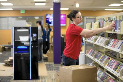 Circulation Assistant II Erin Robbins of Catonsville organizes shelves at the Hereford Branch of the Baltimore County Public Library in Hereford, MD on Tuesday, June 7, 2016. The library is scheduled to reopen June 14.