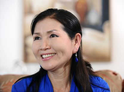 Yumi Hogan, the Korean-born wife of Republican gubernatorial candidate Larry hogan, is an accomplished abstract landscape painter.
